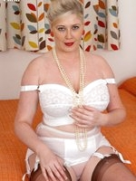Curvy Michelle in full bra, satin garter and chocolate nylons!