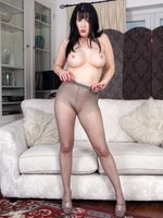 Raunchy, brunette Tanya getting sexy in her grey sheer pantyhose!