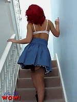 Saucy red head in day clothes and lingerie and stockings, gives naughty upskirt glimpses before doing a sexy striptease.