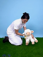Sexy brunette Pin-Up Bryoni-Kate Williams strips as a naughty vet!