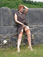Lara flashes her nylon legs and bare pussy out in the woods!