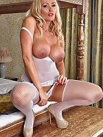 Stunning blonde Milf Lucy Zara teasing in her new white fishnet bodice with matching silky stockings