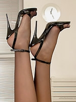 Another chance to enjoy Leanne's long legs this time in a pair of her spiky high heeled sandals