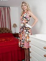 Bianca stripping from her full skirted dress to vintage open cup bra, girdle and