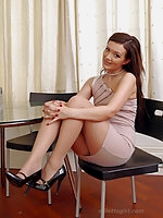 Gorgeous Faye flashes her silky long nylon legs and sexy black high heels up against a table and chair