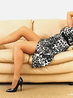 Michelle relaxes in her lounge while allowing you to take a good look at her shoes.