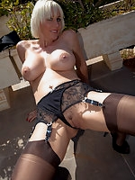 Jan Burton in Leather Mini and Nylons