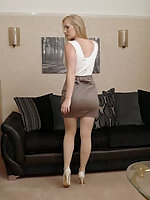 Toni shows her sexy long legs wearing a pair of silky nylons and gorgeous cream stilettos