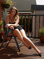 Debbie is outdoors in her favourite high stiletto heels
