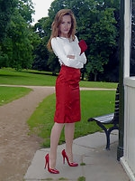 Sophia in a sexy blouse, red skirt and killer red stiletto heels