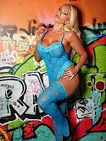 Lucy Zara teasing her amazing pussy lips up against a graffiti wall