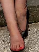 Angel Lovette outdoor in black barefoot stockings